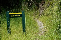 End of track sign on a New Zealand walking track stock images