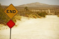 End Traffic Sign. With Bullet Holes. Somewhere in Southern California Mojave Desert. Dirty Dusty Country Road Stock Photos