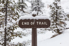 End of Trail Sign in Snowy Forest Stock Photo