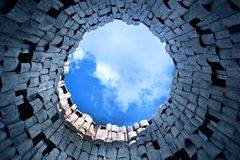 End of the tunnel. View on a blue sky in the end of the tunnel Stock Photos