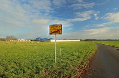 End of the village Kandelin with meadow and road leading to the next village Zarnewanz Royalty Free Stock Photography