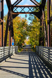 End of walking bridge in the Fall Royalty Free Stock Image