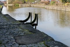 The End of Wigan Pier. The metal ends of the famous Wigan Pier Stock Images