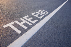 The End Word With Line. Closeup photo of The End Word With Line on the road royalty free stock image