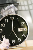 End of work day. Clock, wast paper basket on desk/ end of work day Royalty Free Stock Image