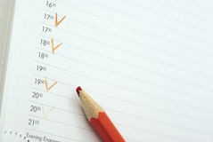 End of the working day. Page of the daily log evening schedule blunt orange pencil stock photo