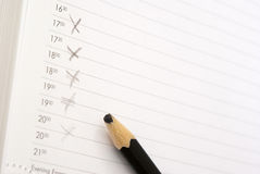End of the working day. Page of the daily log evening schedule of a mark blunt pencil royalty free stock image