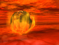 The end of the world. 3d render of the Earth on fire, floating among menacing red clouds.  Image of Earth created from texture map included in standard Royalty Free Stock Photography