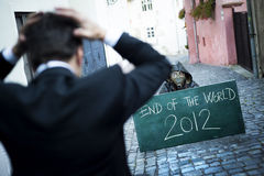 End of the world. Business men is scared of the end of the world Stock Images