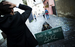 End of the world. Business men is scared of the end of the world Royalty Free Stock Photography