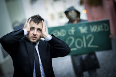 End of the world. Business men is scared of the end of the world Royalty Free Stock Image