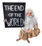 The end of the world. Man carries a sign of the end of the world Royalty Free Stock Photos