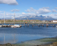 The End of the World. View of the harbour and Fugean Andes in the worlds southern most city of Ushuaia in Argentina Stock Photo