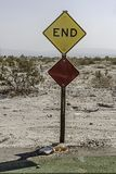 Yellow and diamond shaped road sign `End`. `End` written on a diamond shaped yellow road sign in Salton sea California Royalty Free Stock Photos