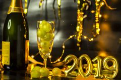 End of the year concept. Glass of champagne with grapes inside. With holiday decoration stock photo