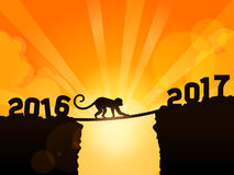 End of Year 2016. Monkey passing 2016 to 2017 Royalty Free Stock Images