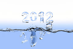 End of year splash concept 2011. Watersurface with the numbers 2011 splashing into the water and 2012 staying over the surface. The numbers are also made of Stock Photo