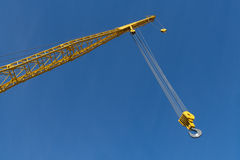 End of Yellow Crane against Blue Sky Stock Photos