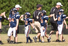 End of a Youth Football Game. At the end of the football game both teams congratulate each other for a game well played.  Here are opposing coaches and team