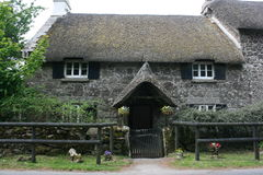 Endearing English thatched cottage. Cute looking traditional thatched cottage in Britain Royalty Free Stock Image