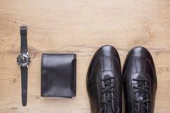 Endecha plana de accesorios para hombre de cuero negros Fotos de archivo libres de regalías