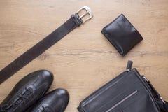 Endecha plana de accesorios para hombre de cuero negros Foto de archivo libre de regalías