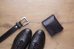 Endecha plana de accesorios para hombre de cuero negros Fotografía de archivo libre de regalías