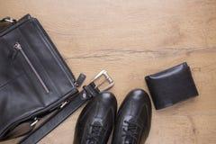 Endecha plana de accesorios para hombre de cuero negros Imagen de archivo libre de regalías
