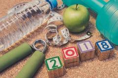 Endecha plana - Feliz Año Nuevo 2018 Aptitud y concepto sano de la consumición Foto de archivo libre de regalías