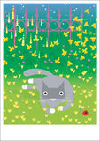 Endechas grises del gato en hierba Foto de archivo