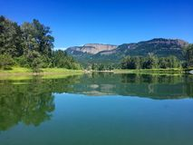 Enderby Cliffs reflecting in Shuswap River, Enderby, British Columbia, Canada stock images