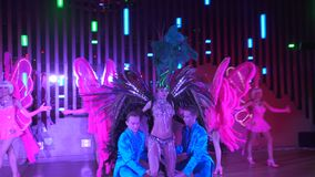 Ending of cabaret show on scene of night club, dancers colorful costumes stock footage