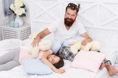 Ending of crazy evening. Having fun pajamas party. Slumber party. Happy fatherhood. Dad and girl relaxing bedroom. Pajamas style. Father bearded men funny stock images