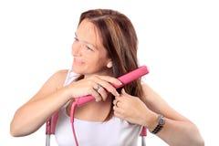 Endireitamento do cabelo Imagem de Stock Royalty Free