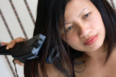 Endireitamento do cabelo Imagem de Stock