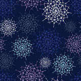 Endless abstract decor pattern with snowflakes Stock Images