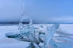 Endless blue ice hummocks in winter on the frozen Lake Baikal. Russia stock photo