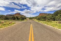 Endless Boynton Pass road in Sedona, Arizona, USA. Endless road at Boynton Road area in Sedona and Red Rock formation on the background Stock Image