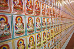 Endless Buddha pattern. In a buddhist temple Stock Photos