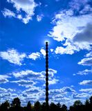 Endless Column in the sky with sun halo shilouette. Monument by Constantin Brancusi