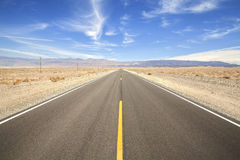 Endless country highway in Death Valley. Royalty Free Stock Images