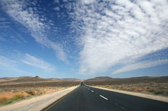 Endless Desert Road. Driving along a road in the middle of nowhere Royalty Free Stock Photo