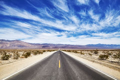 Endless desert road in the Death Valley. Royalty Free Stock Photography