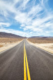 Endless desert road in Death Valley, travel concept. Royalty Free Stock Photography