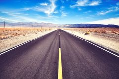 Endless desert road in the Death Valley, USA. Endless desert road in the Death Valley, color toned picture, California, USA stock image