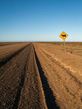 Endless Dirt Road With Cow Sign Stock Photography