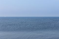Endless Dutch sea with blue sky Royalty Free Stock Image