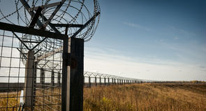 Endless Fence. Long perimener fence with a barbed wire top. Moscow Region, Russia, october Royalty Free Stock Image