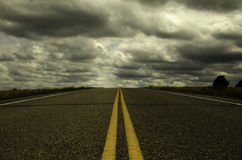 Endless Highway. An endless highway with cloudy sky Stock Photo