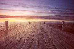 Endless Jetty. Abandoned endless Jetty in warm sunset Stock Photography